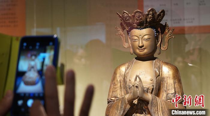 图为敦煌研究院举办的佛教艺术展。(资料图) 魏建军 摄